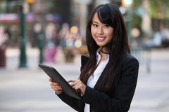 Portrait of businesswoman using tablet pc. Portrait of smiling business woman using tablet pc Royalty Free Stock Photos