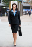 Portrait Of Businesswoman Walking Along Street Stock Images