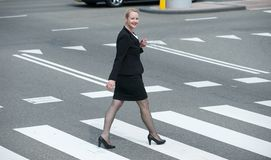Portrait of a businesswoman walking in the city Royalty Free Stock Image