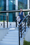 Portrait of businesswoman walking down stairs Royalty Free Stock Photo