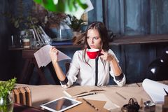 Portrait of a businesswoman who is working at office. And checking details of her upcoming meeting in her notebook and working at loft studio Royalty Free Stock Photos