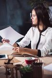 Portrait of a businesswoman who is working at office. And checking details of her upcoming meeting in her notebook and working at loft studio Stock Photos