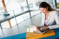 Portrait of businesswoman working on computer in office stock photography