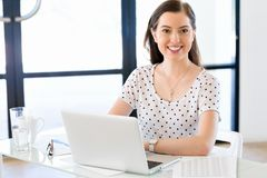 Portrait of businesswoman working at computer in office Stock Photography