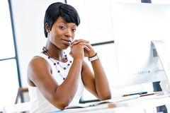 Portrait of businesswoman working at her desk in office. Portrait of young businesswoman with computer at her office Royalty Free Stock Photography