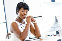 Portrait of businesswoman working at her desk in office Stock Images