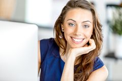 Portrait of businesswoman working at her desk in office Royalty Free Stock Image