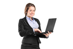 Portrait of a businesswoman working on a laptop Royalty Free Stock Images