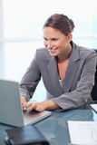 Portrait of a businesswoman working with a laptop Stock Photography