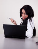 Portrait of businesswoman working in office. Portrait of attractive secretary on her working place Stock Photo