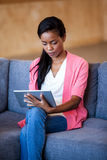 Portrait of businesswoman working with a tablet computer. On a sofa Stock Images