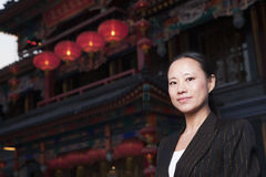 Portrait of businesswomen with Chinese architecture in background. Stock Images