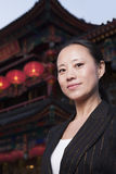 Portrait of businesswomen with Chinese architecture in background. Royalty Free Stock Photo