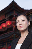 Portrait of businesswomen with Chinese architecture in background. Royalty Free Stock Image