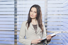 Portrait of businesswomen holding some paperwork. In the office Royalty Free Stock Images