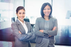 Portrait of businesswomen standing with arms crossed Stock Photo