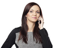 Portrait of a businesswomen talking on the cell phone isolated on white background Stock Images