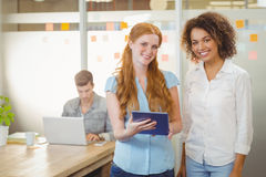 Portrait of businesswomen using digital PC Royalty Free Stock Image
