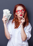 Portrait of a businesswomen in white shirt with money Stock Images