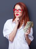 Portrait of a businesswomen in white shirt with money Royalty Free Stock Photo