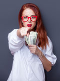Portrait of a businesswomen in white shirt with money Stock Image
