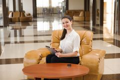Portrait of busy business woman working while sitting at sofa. Small business. royalty free stock photography