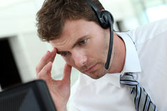 Portrait of busy businessman with headset. Portrait of salesman with headset on Royalty Free Stock Photo