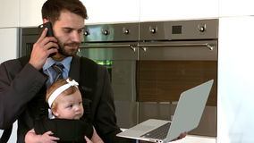 Portrait of busy father multi tasking stock footage