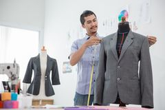 Fashion designer make a suit. Portrait of busy male fashion designer make a suit in his workshop Royalty Free Stock Image