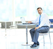 Portrait of busy manager typing on the laptop Stock Photo