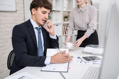 Business Executive Busy Working in Office Stock Photography