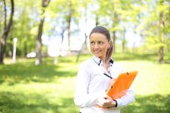 Portrait of busy sales woman at park. Portrait of busy sales woman at business park Stock Image