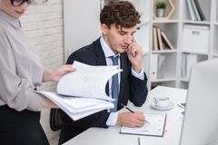 Young Businessman Busy Working in Office stock photo