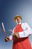 Portrait of butcher sharpening serrated knife Stock Image