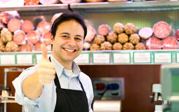 Butcher at work. Portrait of a butcher at work in a supermarket stock images