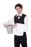 Portrait of a butler with bottle of champagne Royalty Free Stock Photo