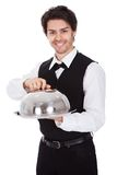 Portrait of a butler with bow tie and tray Stock Photo