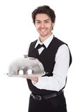 Portrait of a butler with bow tie and tray Royalty Free Stock Images