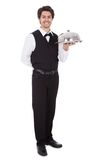 Portrait of a butler with bow tie and tray Royalty Free Stock Photo