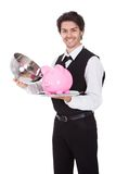 Portrait of a butler with piggybank Royalty Free Stock Photography