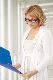 Portrait of cacuasian blond woman with folder Royalty Free Stock Photos