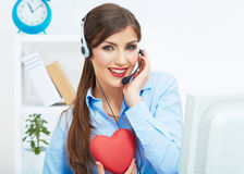 Portrait of call center smiling operator with phone headset iso Stock Photos