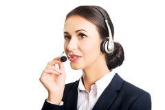Portrait of call center woman talking to customer Stock Image