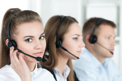 Portrait of call center worker accompanied by her team Royalty Free Stock Photography