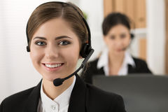 Portrait of call center worker accompanied by her team Royalty Free Stock Images