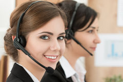 Portrait of call center worker accompanied by her team Royalty Free Stock Photos