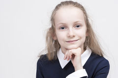 Portrait of Calm and Beautiful Caucasian Female Child with Wonderful Deep Eyes. Royalty Free Stock Photos