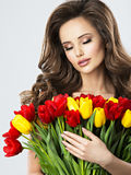 Portrait of calm beautiful young woman with flowers. Royalty Free Stock Image