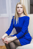 Portrait of Calm Blond Woman Sitting in Light Chair. Stock Images