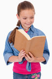 Portrait of a calm girl reading a book Royalty Free Stock Photography